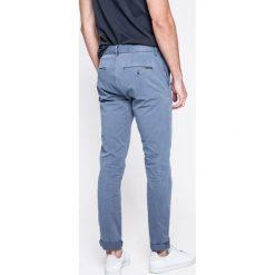 Calvin Klein Jeans - Jeansy. Szare jeansy męskie z dziurami marki Calvin Klein Jeans. W wyprzedaży za 269,90 zł.