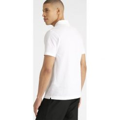Lacoste Sport Tshirt basic blanc. Białe koszulki polo Lacoste Sport, m, z bawełny. W wyprzedaży za 260,10 zł.