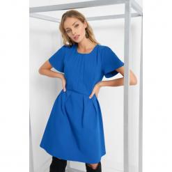 Rozkloszowana sukienka. Czarne sukienki mini marki Orsay, xs, z bawełny, z dekoltem na plecach. Za 139,99 zł.