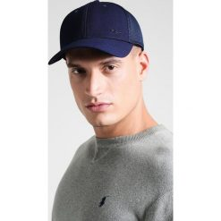 Polo Ralph Lauren Golf POLY TWILL FLEX FIT Czapka z daszkiem french navy. Niebieskie czapki męskie marki Eisbär, z materiału. W wyprzedaży za 127,20 zł.