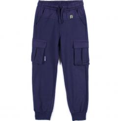 Spodnie. Niebieskie chinosy chłopięce LONGBOARD, z bawełny. Za 29,90 zł.