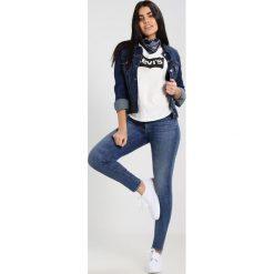 Levi's® 711 SKINNY Jeans Skinny Fit antiqued. Niebieskie rurki damskie Levi's®. Za 399,00 zł.