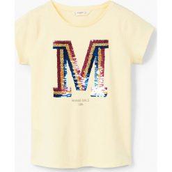 Mango Kids - Top dziecięcy Mangos2 110-164 cm. Białe bluzki dziewczęce bawełniane Mango Kids, z aplikacjami, z okrągłym kołnierzem, z krótkim rękawem. W wyprzedaży za 29,90 zł.
