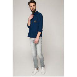 Calvin Klein Jeans - Jeansy Electronic Grey. Szare jeansy męskie slim marki Calvin Klein Jeans, z bawełny. W wyprzedaży za 359,90 zł.