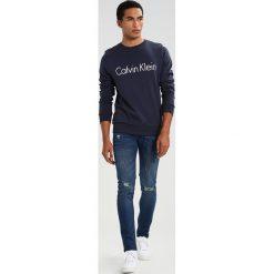 Calvin Klein KAI Bluza blue. Pomarańczowe kardigany męskie marki Calvin Klein, l, z bawełny, z okrągłym kołnierzem. W wyprzedaży za 359,10 zł.