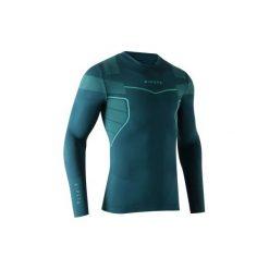 Podkoszulek do piłki nożnej długi rękaw Keepdry 500. Czarne odzież termoaktywna męska marki KIPSTA, m, z elastanu, z długim rękawem, na fitness i siłownię. Za 49,99 zł.