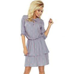 Sukienka z podwójną spódnicą sf-182-2. Niebieskie sukienki z falbanami marki SaF, na co dzień, xl, z żakardem, z asymetrycznym kołnierzem, dopasowane. Za 179,90 zł.