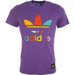 Adidas Koszulka męska Pharrell Williams Supercolor Trefoil Tee fioletowa r. L (AC5936). Białe t-shirty męskie marki Adidas, m. Za 96,23 zł.