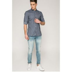 Tommy Jeans - Koszula. Szare koszule męskie jeansowe Tommy Jeans, m, button down, z długim rękawem. W wyprzedaży za 219,90 zł.