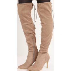 Beżowe Kozaki Ricci. Brązowe buty zimowe damskie marki Kazar, ze skóry, przed kolano, na wysokim obcasie. Za 89,99 zł.