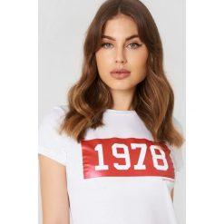 Calvin Klein T-shirt Tamar-50 Crew Neck - White. Białe t-shirty damskie Calvin Klein, z nadrukiem, z dzianiny. Za 202,95 zł.
