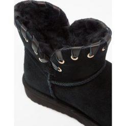UGG AIDAH MINI Śniegowce black. Czarne buty zimowe damskie Ugg, z wełny. Za 889,00 zł.