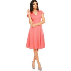 Malinowa Elegancka Rozkloszowana Sukienka z Mini Rękawkiem. Różowe sukienki balowe marki numoco, l, z dekoltem w łódkę, oversize. W wyprzedaży za 120,81 zł.