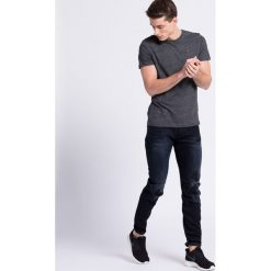 G-Star Raw - Jeansy. Niebieskie jeansy męskie slim marki House. W wyprzedaży za 399,90 zł.