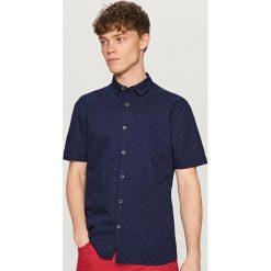 Koszula z krótkim rękawem - Niebieski. Brązowe koszule chłopięce marki QUECHUA, m, z elastanu, z krótkim rękawem. W wyprzedaży za 19,99 zł.