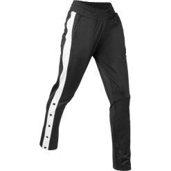 Spodnie sportowe, z rozpinanymi nogawkami, długie bonprix czarny. Czarne bryczesy damskie marki bonprix, w paski. Za 89,99 zł.