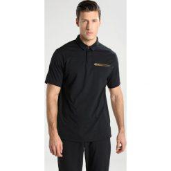 Under Armour PERPETUAL POLO Koszulka polo black. Czarne koszulki sportowe męskie Under Armour, m, z elastanu. Za 419,00 zł.