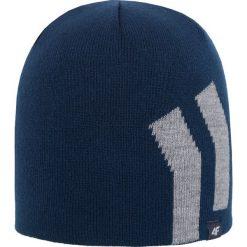 Czapka męska CAM251Z - niebieski ciemny. Niebieskie czapki zimowe męskie 4f, z materiału. Za 22,99 zł.