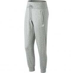 New Balance WP81548AG. Szare spodnie dresowe damskie marki New Balance, xs, z dresówki. W wyprzedaży za 129,99 zł.