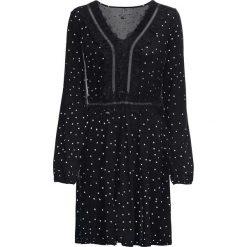 Sukienka w kropki bonprix czarno-biel wełny w kropki. Czarne sukienki koronkowe marki bonprix, w koronkowe wzory, z dekoltem w serek. Za 109,99 zł.