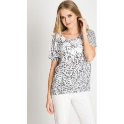 Bluzki damskie: Oversizowa bluzka z kwiatowym nadrukiem QUIOSQUE