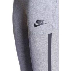 Nike Performance PANT Spodnie treningowe carbon heather/black. Szare spodnie chłopięce Nike Performance, z bawełny. W wyprzedaży za 209,30 zł.