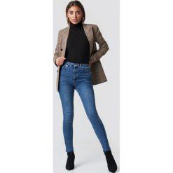 Spodnie damskie: NA-KD Jeansy Skinny High Waist Raw Hem - Blue