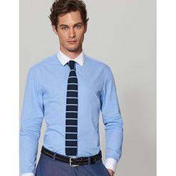 Bawełniana koszula slim fit - Niebieski. Niebieskie koszule męskie slim marki Reserved, m, z nadrukiem, z bawełny. Za 119,99 zł.