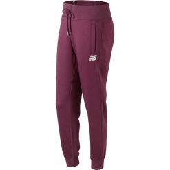 New Balance WP73535WNS. Brązowe spodnie dresowe damskie New Balance, xs, z bawełny. W wyprzedaży za 149,99 zł.