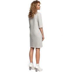 EMELINE Dzianinowa sukienka z zakładką na dole - popielata. Szare sukienki dzianinowe Moe, na co dzień, s. Za 119,00 zł.