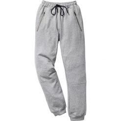 Spodnie dresowe Slim Fit bonprix jasnoszary melanż. Czarne rurki męskie marki New Balance, na jesień, z dresówki. Za 89,99 zł.