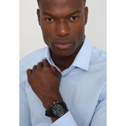 Armani Exchange Zegarek schwarz. Czarne zegarki męskie marki Armani Exchange, l, z materiału, z kapturem. Za 579,00 zł.