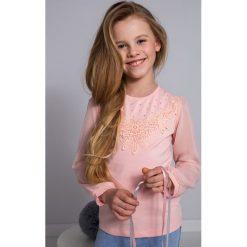 T-shirty dziewczęce: Jasnoróżowa bluzka dziewczęca z dżetami NDZ36025