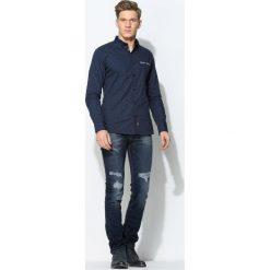 Granatowe Jeansy Flip Over. Czarne jeansy męskie marki Born2be, l, z aplikacjami, z dresówki. Za 89,99 zł.