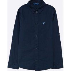 Guess Jeans - Koszula dziecięca 118-176 cm. Czarne koszule chłopięce z długim rękawem Guess Jeans, l, z aplikacjami, z bawełny, z klasycznym kołnierzykiem. W wyprzedaży za 129,90 zł.