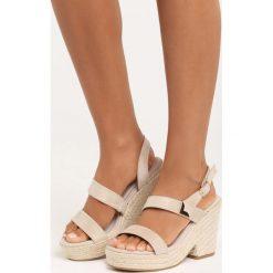 Beżowe Sandały Sheets. Brązowe sandały damskie Born2be, z materiału, na koturnie. Za 49,99 zł.