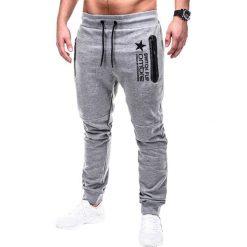 SPODNIE MĘSKIE DRESOWE P420 - SZARE. Szare spodnie dresowe męskie Ombre Clothing, z nadrukiem, z bawełny. Za 49,00 zł.
