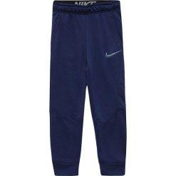 Chinosy chłopięce: Nike Spodnie  juniorskie NK Dry Pant Taper FLC niebieskie 152 cm (856168 429)