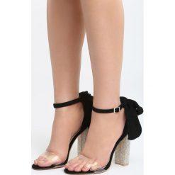 Czarne Sandały Star Light. Czarne sandały damskie na słupku marki Born2be, z materiału, na wysokim obcasie. Za 89,99 zł.