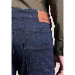 BOSS Orange Jeansy Slim Fit blue denim. Niebieskie jeansy męskie relaxed fit BOSS Orange. W wyprzedaży za 383,20 zł.