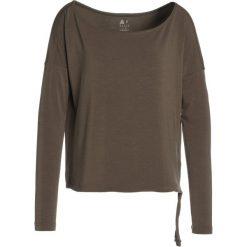 Reebok NATURE X  Bluzka z długim rękawem army green. Brązowe topy sportowe damskie Reebok, m, z elastanu, sportowe, z długim rękawem. Za 339,00 zł.