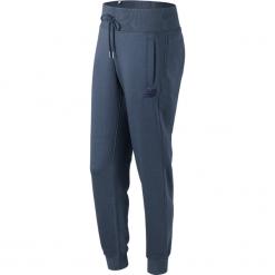 Spodnie dresowe damskie: New Balance WP73535VTI