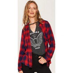 Koszula w kratę - Niebieski. Czarne koszule damskie marki KIPSTA, z poliesteru, do piłki nożnej. Za 79,99 zł.