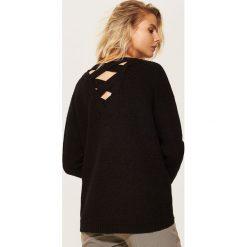 Sweter oversize - Czarny. Czarne swetry oversize damskie marki KIPSTA, z poliesteru, do piłki nożnej. Za 89,99 zł.