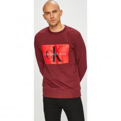 Calvin Klein Jeans - Bluza. Brązowe bejsbolówki męskie Calvin Klein Jeans, l, z nadrukiem, z bawełny, bez kaptura. Za 399,90 zł.