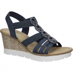 Niebieskie sandały z cekinami na koturnie Rieker 65515-14. Niebieskie sandały damskie Rieker, na koturnie. Za 228,99 zł.