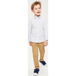 Bawełniana koszula w kratkę - Niebieski. Białe koszule męskie w kratę marki Reserved, m. Za 119,99 zł.