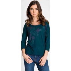 Bluzki asymetryczne: Zielona bluzka z metalicznym kwiatowym nadrukiem QUIOSQUE