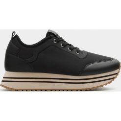 Buty sportowe damskie: Modne czarne buty sportowe na platformie