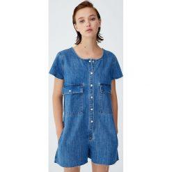 Jeansowy kombinezon z kieszeniami. Niebieskie kombinezony damskie Pull&Bear, z jeansu. Za 69,90 zł.